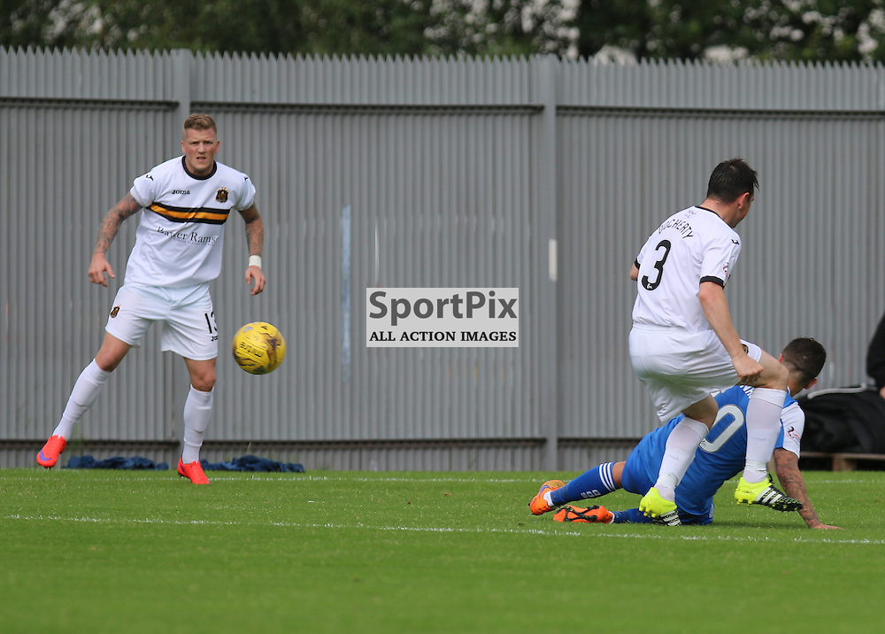 Ryan Conroy slides in on Mark Dochertyduring the Dumbarton FC V Queen of the South FC Scottish Championship 22th August 2015 <br /> <br /> (c) Andy Scott | SportPix.org.uk