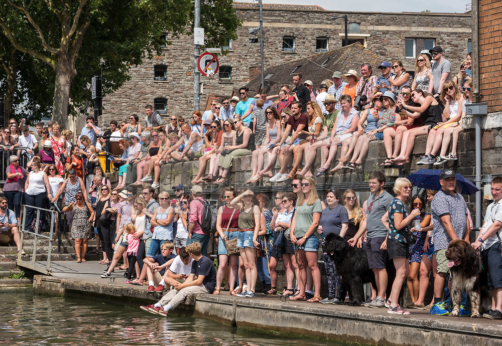 © Licensed to London News Pictures.  21/07/2018; Bristol, UK. Bristol Harbour Festival. People enjoy the good weather during the Bristol Harbour Festival in the city centre of Bristol. Bristol Harbour Festival is a 3 day extravaganza of dance, music, theatre, circus, ships and boats, arts and delicious food. The festival is free for all and brings over 250,000 people together each summer to celebrate Bristol's rich maritime history and enjoy some of the city's best music and entertainment. The festival takes place on the  20 - 22 July 2018. Photo credit: Simon Chapman/LNP
