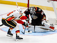 Calgary Flames forward Matt Stajan (L) tries to get a shot in on Anaheim Ducks goalie John Gibson during a 2017-2018 NHL hockey game in Anaheim, California, the United States, on Oct. 9, 2017.  Calgary Flames won 2-0. (Xinhua/Zhao Hanrong)