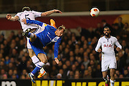 Jan Vertonghen of Tottenham Hotspur and Roman Zozulya of Dnipro Dnipropetrovsk in an aerial battle during the UEFA Europa League match at White Hart Lane, London<br /> Picture by David Horn/Focus Images Ltd +44 7545 970036<br /> 27/02/2014