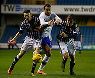 Picture by David Horn/Focus Images Ltd +44 7545 970036<br /> 28/01/2014<br /> Scott Malone of Millwall (left) and Shane Lowry of Millwall (right) block off Atdhe Nuhiu of Sheffield Wednesday (centre) during the Sky Bet Championship match at The Den, London.
