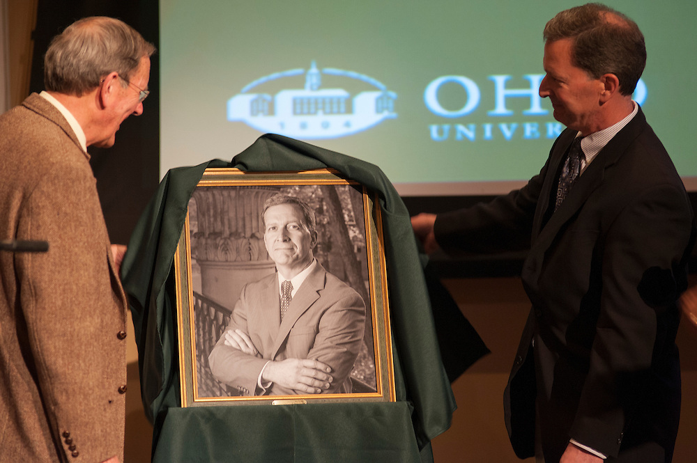 The 2013 Distinguished Professor, Dr. Thomas Carpenter, and the most recent Distinguished Professor Dr. Christopher France, unveil Dr. France's portrait in Baker Center Ballroom on Tuesday, March 10.