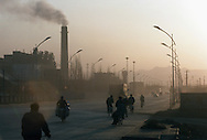 Air pollution near the Number One coal fired power plant. 75% of China's growing energy needs is supplied by coal, the cheapest and dirtiest form of energy. China is the world's largest producer of coal. Seven of the world's ten most polluted cities are in China, largely due to coal use and the country's dilapidated heavy industries..Dàtóng, Shanxi Province, China. 12/11/2005.Photo © J.B. Russell