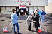 Mar. 6, 2010 -- PHOENIX, AZ: A woman poll worker frisks Iraqi women coming to vote at the polling place for the Iraqi national election in Phoenix, AZ, Saturday, March 6. Phoenix is one eight cities in the United States where Iraqi citizens can vote in their national parliamentary elections. Voting started Friday and will end Sunday. Election workers said they expected between 4,000 and 6,000 people would vote at the Phoenix polling place.   Photo by Jack Kurtz