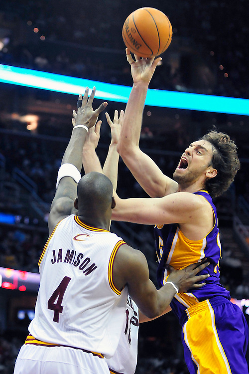 Feb. 16, 2011; Cleveland, OH, USA; Los Angeles Lakers power forward Pau Gasol (16) is fouled by Cleveland Cavaliers shooting guard Anthony Parker (18) as he shoots over power forward Antawn Jamison (4) during the third quarter at Quicken Loans Arena. The Cavaliers beat the Lakers 104-99. Mandatory Credit: Jason Miller-US PRESSWIRE