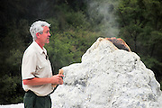 New Zealand, North Island, Rotorua, The Te Puia Geothermal Cultural Experience, Pohutu Geyser. Park guide at the geyser