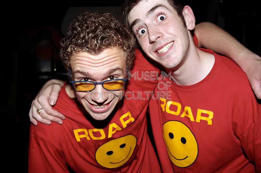 Two blokes wearing 'Roar' T shirts, Roar, Evolution, Cardiff, Wales, 2001