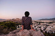 Taking in the view of the Acropolis from the Filopappou Hill (Hill  of the Muses) in Athens, Greece.