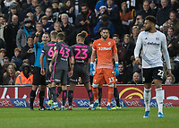 Football - 2019 / 2020 Sky Bet (EFL) Championship - Fulham vs. Leeds United<br /> <br /> Leeds players surround Referee T Robinson after he awards Fulham an early penalty at Craven Cottage<br /> <br /> COLORSPORT/DANIEL BEARHAM