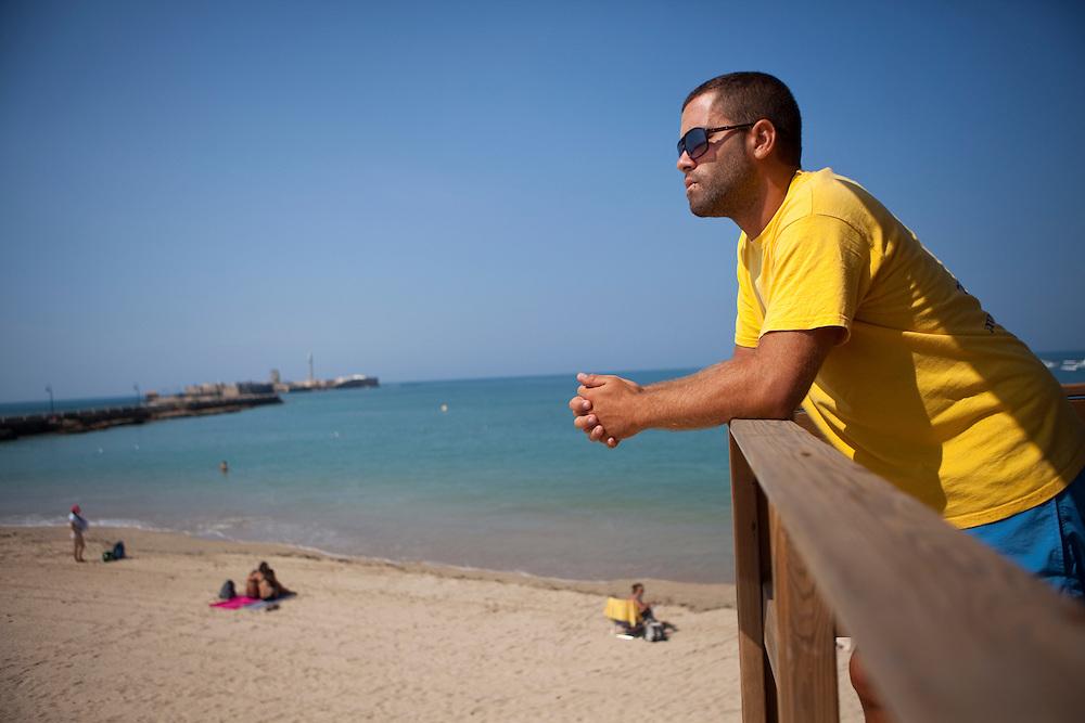 Lifegard on duty at La Caleta beach, at La Viña, the old fisherman quarter in Cádiz, Andalucía, Spain.