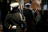 Warren Chou (cq) (right), of the Metropolitan Fire Association, speaks to members of The DeKalb County Fire Dept. color guard at The Spotted Dog--which used to house Fire Station 11--before the start of a commemoration to mark the 60th anniversary of the Winecoff Hotel fire in downtown Atlanta. The fire--at 119 deaths, the worst hotel fire in U.S. history--caused departments across the country to update their safety codes.