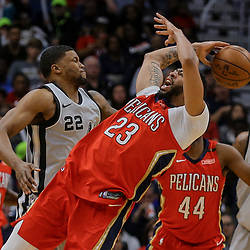 Apr 11, 2018; New Orleans, LA, USA; New Orleans Pelicans forward Anthony Davis (23) is fouled by San Antonio Spurs forward Rudy Gay (22) during the first quarter at the Smoothie King Center. Mandatory Credit: Derick E. Hingle-USA TODAY Sports