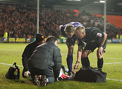 BLACKPOOL, ENGLAND - Tuesday, January 25, 2011: Manchester United's Rafael Da Silva goes down injured as goalkeeper Edwin van der Sar and referee Peter Walton look on during the Premiership match against Blackpool at Bloomfield Road. (Photo by David Rawcliffe/Propaganda)