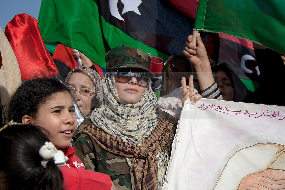 © licensed to London News Pictures. BENGHAZI. 15/04/2011.  A woman in millitary uniform heads the frontline at this womans' march against Qaddafi in Benghazi.  Please see special instructions for usage rates. Photo credit should read ISMAIL NEGM/LNP