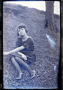 young adutl girl by her self sitting eroding vintage image