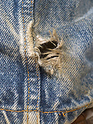 extreme close up of jeans with a hole