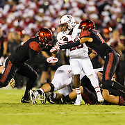 16September 2017: The San Diego State Aztecs defense makes a group tackle on Stanford Cardinal running back Bryce Love (20) in the first quarter. The Aztecs lead Stanford 10-7 at half time at San Diego Stadium. <br /> www.sdsuaztecphotos.com