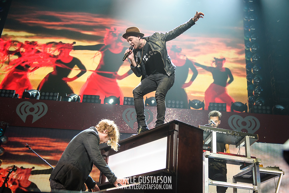 "WASHINGTON, DC - December 15th, 2014 - Brent Kutzle and Ryan Tedder of One Republic  perform onstage during HOT 99.5's Jingle Ball 2014 at the Verizon Center in Washington, D.C. Their hits include ""Counting Stars"" and ""Good Life."" (Photo By Kyle Gustafson / For The Washington Post)"