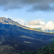 INDONESIA. Kintamani, Bali. June 8th, 2013. Gunung Agung, Eastern Bali's most active volcano, dominates the horizon. It is the highest volcano on the island resting at an altitude of 3,142 meters and is the fifth highest in the whole of Indonesia.