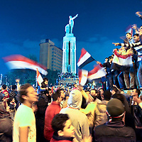 Anti government protesters celebrate near Tahrir Square after the announcement of Egyptian President Hosni Mubarak's resignation in Cairo, Egypt. February 2011.