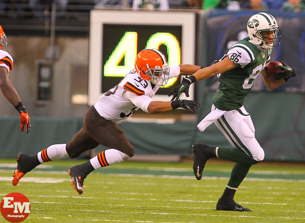 Dec 22, 2013; East Rutherford, NJ, USA; New York Jets wide receiver David Nelson (86) breaks a tackle by Cleveland Browns cornerback Jordan Poyer (33) during the second half at MetLife Stadium.  The Jets defeated the Browns 24-13.