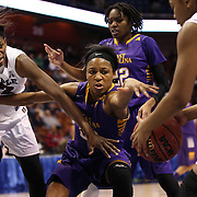 Jada Payne, (center), East Carolina, challenges for a rebound with Mama Traore, (left), Temple, during the Temple Vs East Carolina Quarterfinal Basketball game during the American Women's College Basketball Championships 2015 at Mohegan Sun Arena, Uncasville, Connecticut, USA. 7th March 2015. Photo Tim Clayton