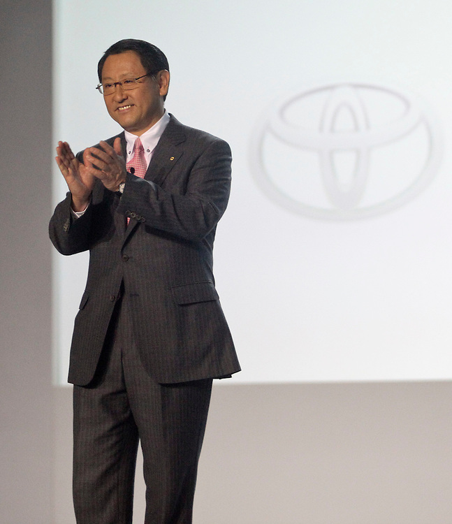 GR --- Detroit, Michigan ---11-01-10---Akio Toyoda, President of Toyota Motor Corp applauds during a press conference at the North American International Auto Show in Detroit, Michigan January 10, 2011.<br /> Geoff Robins AFP
