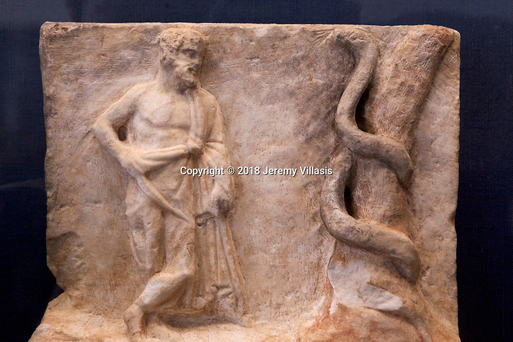 Marble votive relief with a representation of Asklepios beside a tree trunk which a serpent coils (3rd century BC)