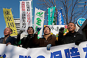 "Makoto Yuasa (second from left) leads a march to the Japanese government building after the Anti poverty Protest ""Tent Village"" in Hibiya Park in central Tokyo. Japan. Monday January 5th 2009  Organised by the Moyai Foundation, headed by Makoto Yuasa, the event lasted for six days over the New Year`s holiday in 2009 about 1,600 volunteers helped over 500 of Japan`s homeless and unemployed with food, shelter and advice."