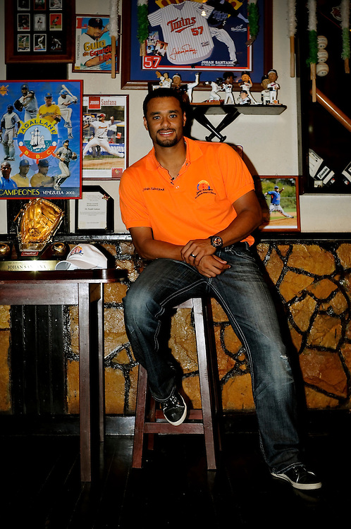 Johan Santana poses for a portrait in a memorabilia room his parents made in the home he grew up in, in Tovar, Venezuela. Santana said he gave most of his first paycheck to his parent's to remodel their modest home in Tovar. The room features memorabilia from old jerseys, posters, bobble heads and championship rings.