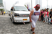 XI\'AN, CHINA - APRIL 12: (CHINA OUT) <br /> <br /> MAN Pull's 3.3 Ton Vehicle With Teeth <br /> <br /> 35-year-old Zhang Hongqi pulls a 3.3-ton vehicle with his teeth on April 12, 2014 in Xi'an, Shaanxi Province of China.<br /> ©Exclusivepix