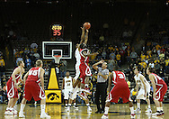 21 JANUARY 2009: Iowa's David Palmer (2) and Wisconsin's Marcus Landry (1) battle for the opening tipoff during the first half of an NCAA college basketball game Wednesday, Jan. 21, 2009, at Carver-Hawkeye Arena in Iowa City, Iowa. Iowa defeated Wisconsin 73-69 in overtime.