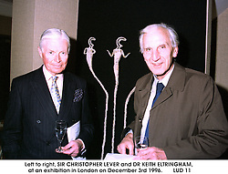 Left to right, SIR CHRISTOPHER LEVER and DR KEITH ELTRINGHAM,<br />  at an exhibition in London on December 3rd 1996.<br />       LUD 11