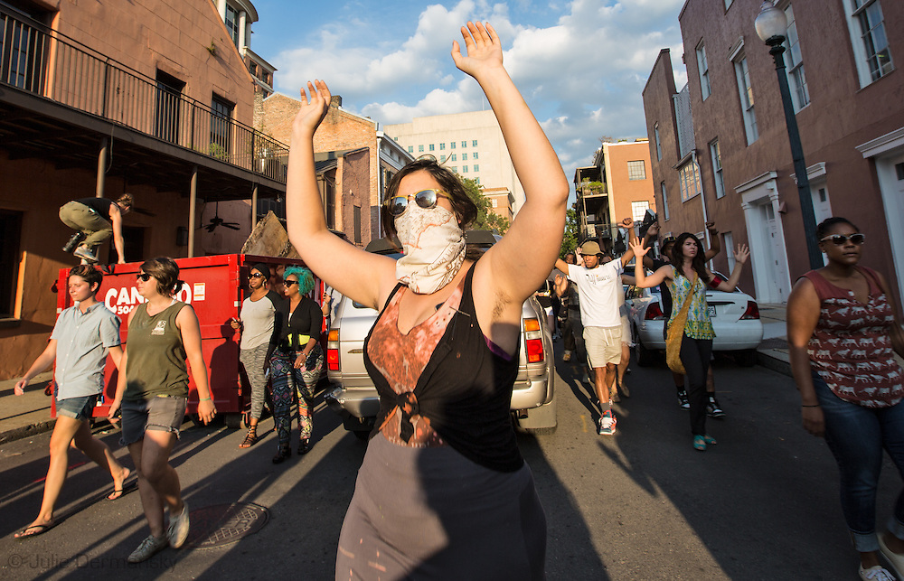Protesters in New Orleans take to the streets of the French Quarter after a vigil for Michael Brown, part of a  protest in solidarity with the people of Ferguson Missouri for Michael Brown who was killed by police in Ferguson on August 9, 2014. THe protest was one of many  held across the country. ©2104 Juiie Dermansky