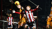 Sam Clucas and Ryan Woods battle for the loose ball during the Sky Bet Championship match between Brentford and Hull City at Griffin Park, London, England on 3 November 2015. Photo by Michael Hulf.
