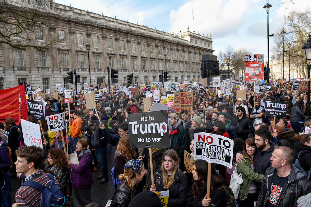 © Licensed to London News Pictures. 04/02/2017. London, UK. Placards are held aloft as thousands of people, standing against racism and Islamophobia, are seen in Whitehall outside Downing Street to oppose the travel ban on Muslims, from seven countries, imposed by Donald Trump, U.S. President. Photo credit : Stephen Chung/LNP