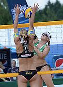 STARE JABLONKI POLAND - July 5: Katharina Schutzenhofer and Doris Schwaiger /1/ of Austria in action during Day 5 of the FIVB Beach Volleyball World Championships on July 5, 2013 in Stare Jablonki Poland.  (Photo by Piotr Hawalej)