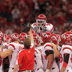 2 January 2009: Utah cornerback Damilyn Tanner (14) during a pregame huddle prior to kickoff of the 75th annual All State Sugar Bowl  between the Utah Utes and the Alabama Crimson Tide at the Louisiana Superdome in New Orleans, LA.