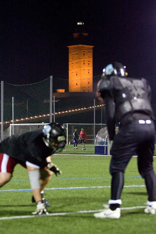 (A Coruña, Spain - April 13, 2010) - Under the light of the Tower of Hercules, the Galicia Black Towers practice on a city soccer field on Tuesday night in A Coruña. The team of less than 10 members from the area practices here every Tuesday for two hours, doing mostly tackling drills. The main practice is in Santiago de Compostela every Sunday at 10am. ..Photo by Will Nunnally / Will Nunnally Photography