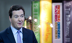 © Licensed to London News Pictures. 07/10/2012. Birmingham , UK . Chancellor George Osborne in front of giant books of Peter Pan , Charlie and the Chocolate Factory , Protecting Teachers Defending Education and The Bad Beginning - a series of unfortunate events . Conservative Party Conference Day 1 at the International Convention Centre . Photo credit : Joel Goodman/LNP