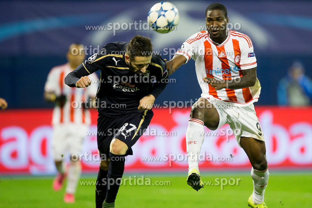 Jeremy Taravel #87 of GNK Dinamo Zagreb and Alfred Finnbogason #9 of Olympiakos during football match between GNK Dinamo Zagreb and Olympiakos in Group F of Group Stage of UEFA Champions League 2015/16, on October 20, 2015 in Stadium Maksimir, Zagreb, Croatia. Photo by Urban Urbanc / Sportida
