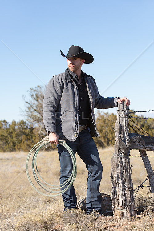 muscular cowboy on a ranch