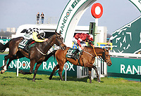 National Hunt Horse Racing - 2018 Randox Health Grand National Festival - Friday, Day Two (Ladies Day)<br /> <br /> Tiger Roll wins the 179th Grand National in a photo finish from Pleasant Company in an epic finish, in the 17.15 Weatherby's racing bank Standard open National Hunt flat race, at Aintree Racecourse.<br /> <br /> COLORSPORT/ANDREW COWIE