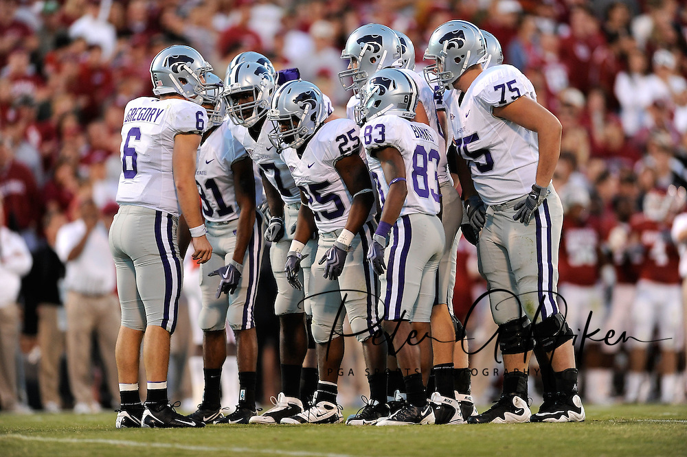 NORMAN, OK - OCTOBER 31:  31:  Quarterback Grant Gregory #6 of the Kansas State Wildcats huddles up the offense in the first half against the Oklahoma Sooners on October 31, 2009 at Gaylord Family Oklahoma Memorial Stadium in Norman, Oklahoma.  (Photo by Peter G. Aiken/Getty Images)