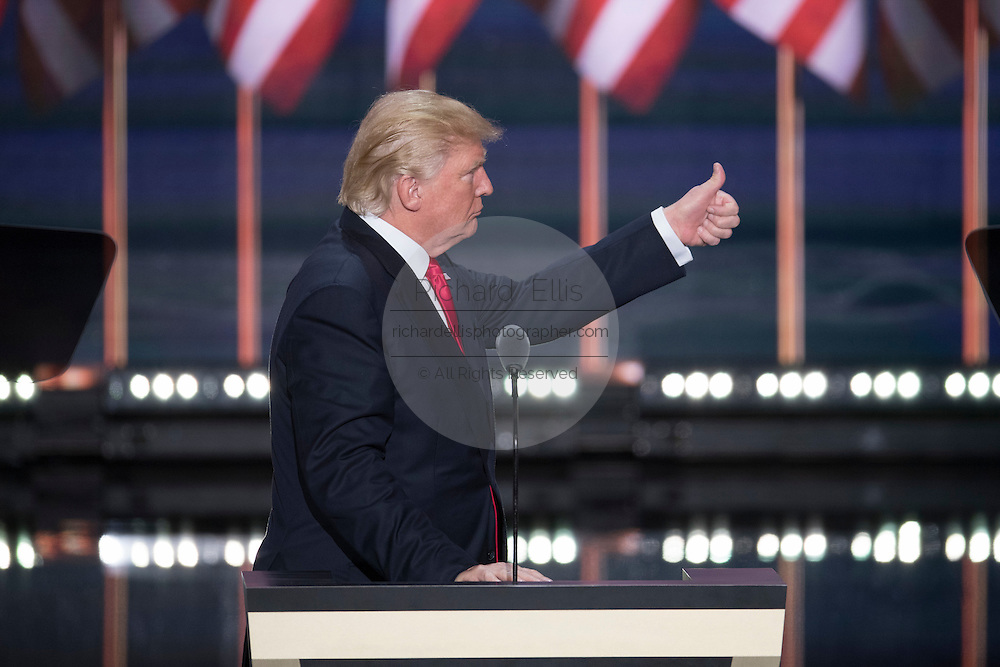 GOP Presidential candidate Donald Trump gives a thumbs up to Police after they removed a Code Pink protester who interrupted his acceptance speech on the final day of the Republican National Convention July 21, 2016 in Cleveland, Ohio.