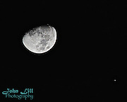 The moon as seen from San Diego with Jupiter in the distance. Photo by John Lill.