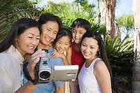 Family Looking at Video Camera Screen