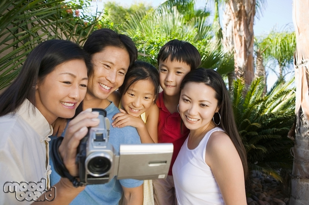 Family Looking at Video Camera Screen