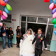 Newlyweds leave the church on their wedding day in Namasiya Township, Kaoshiung County, Taiwan