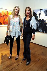 Left to right, CAMILLA SIMON and her mother KATE SIMON at an exhibition of Tahnee Lonsdale's paintings held at The Commander, 47 Hereford Road, London on 8th October 2008.